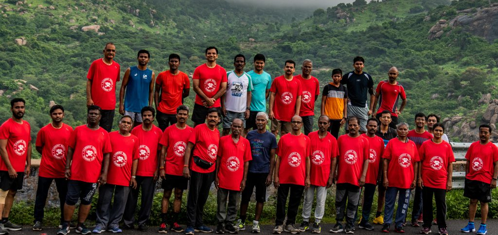 group of men and women who are running to recover after heart problems