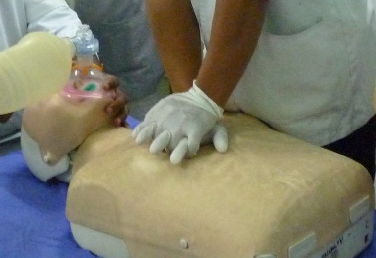 learning cpr on a test dummy. learning cpr could save someones life