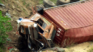 a lorry lies at the side of the road after a bad accident