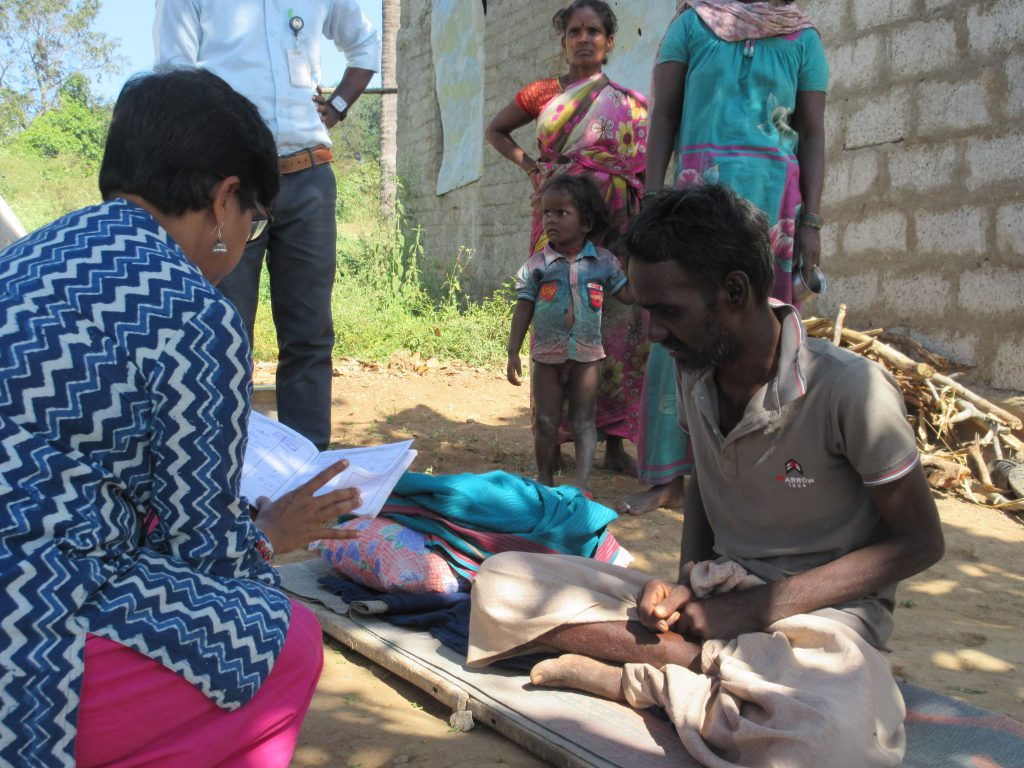a doctor reads the medical records of a manin the jawadhi hills