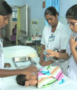 nurses check a new bordn child