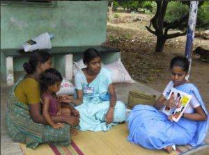 comunity nurses vising a mother and child fin their village. the nurses come from the CMC Vellore Chittoor hospital