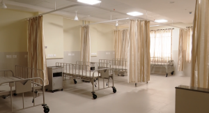 beds in the ward with no mattresses yet