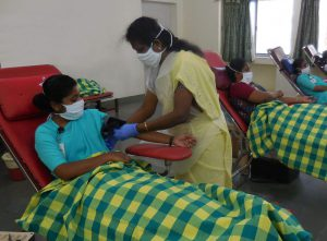 staff giving blood at a CMC Vellore blood camp