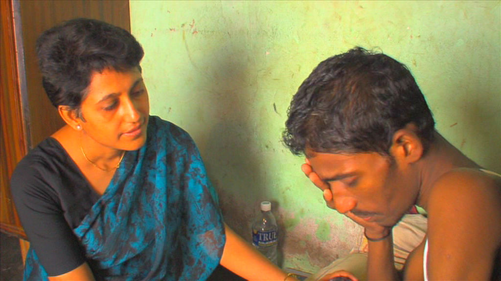 Dr Reena  providing care for  a patient in the community
