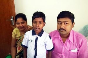 Kamu with his parents in the medical genetics at CMC Vellore outpatients
