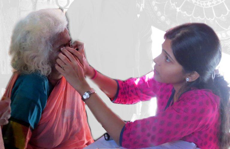 examining an elderly ladies eyes at an eye camp, ophthalmology dept, CMC Vellore