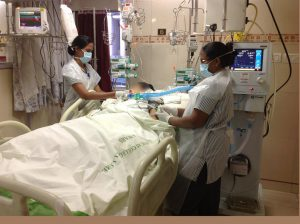 Nurses care for a patient after a liver transplant in ICU 2014