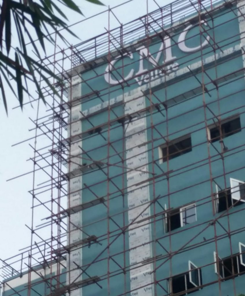 top of the new orthopaedic block with the CMC Vellore sign on it