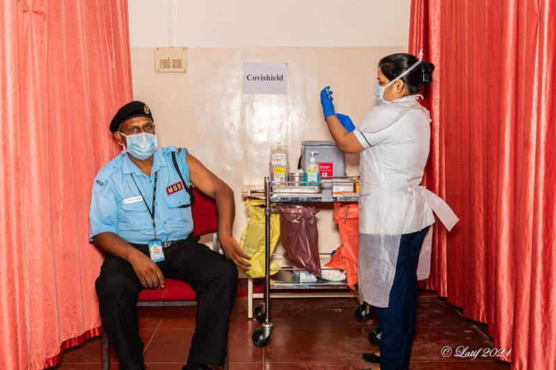 The nurse gets the vaccination ready