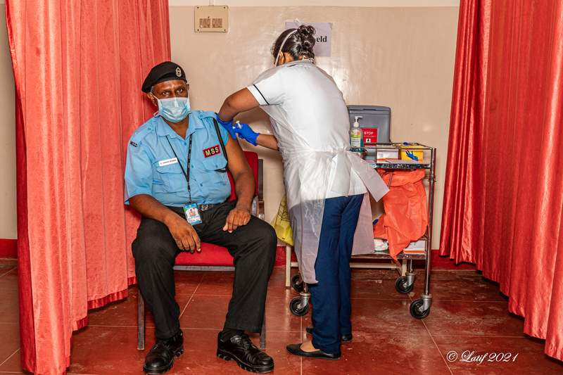 vaccination is given by the nurse into the top of the arm